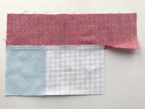 katoenen lapjes aan elkaar naaien